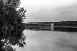 A black and white photo of the dam on Lake Galena at Peace Valley Park