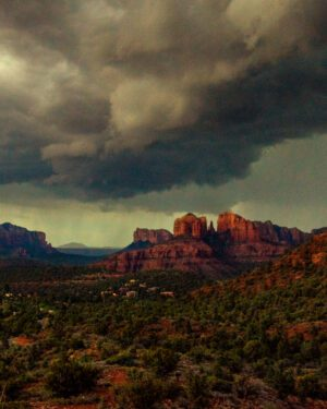 A photograph of dramatic clouds coming in over the Sedona, AZ red rocks